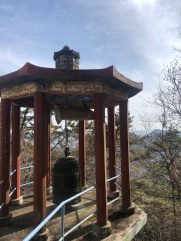 Traditional Korean structures housing a bell with a phenomenal view